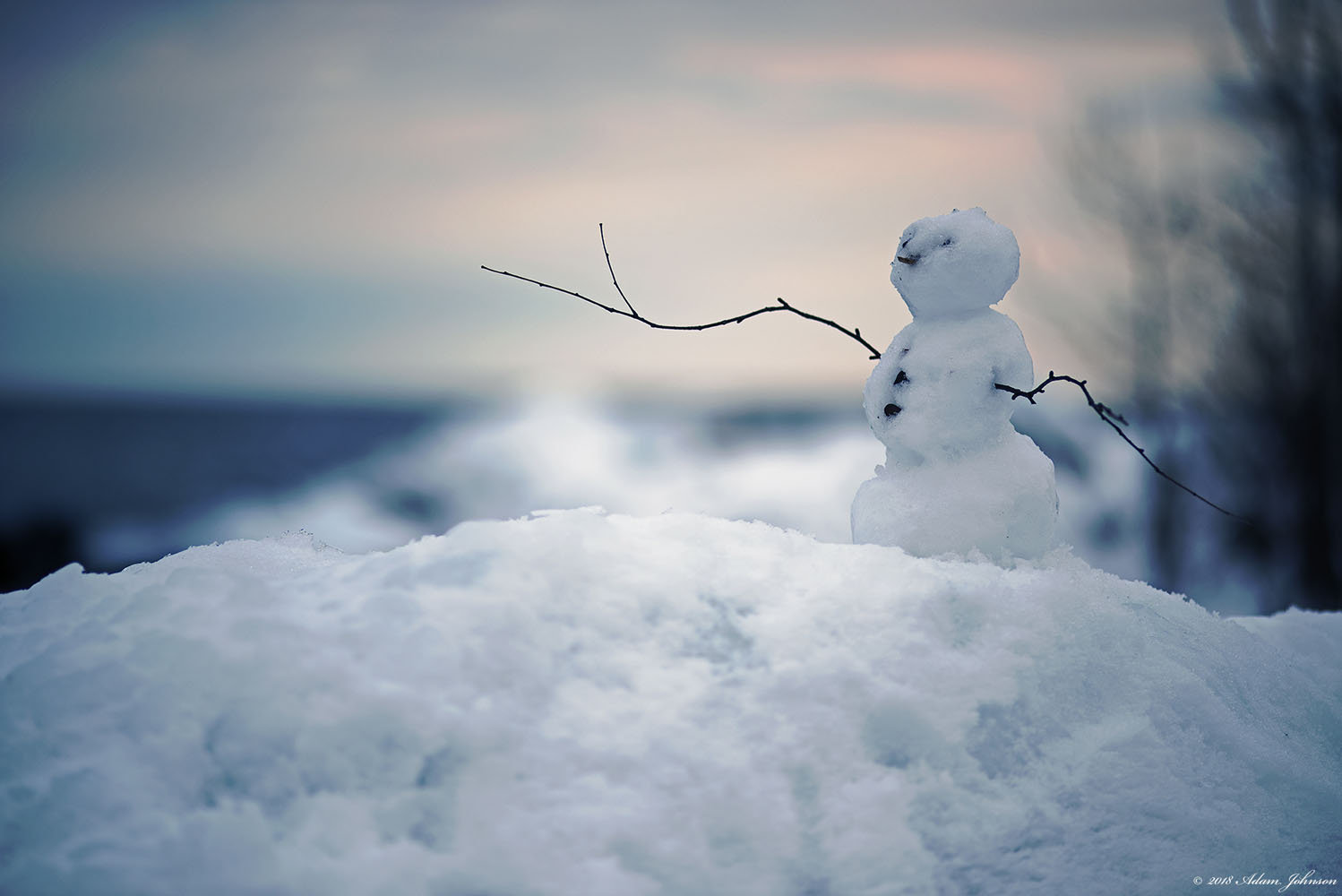 Tiny snowman created on Lake Superior Beach - Tettegouche State Park